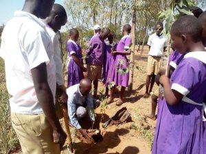 Photo of The Deputy Headmaster planting a tree for Tree Planting Ceremony