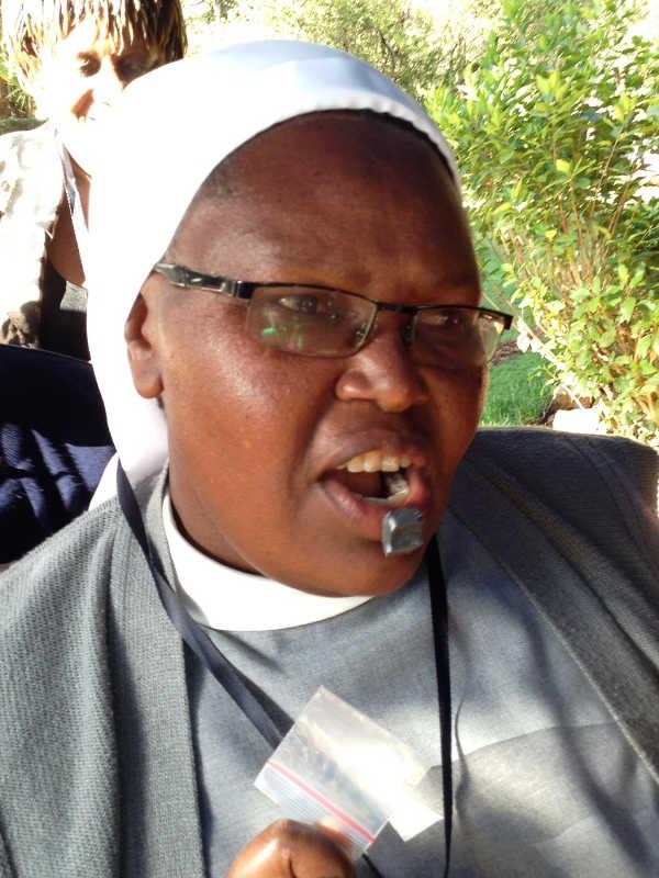 Photo of Sister Francisca testing black stone