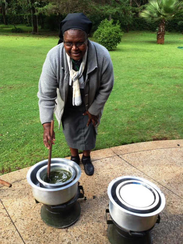 Photo of Sr Francisca stirs an ointment in water bath during seminar May 2018